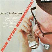 Man bites harmonica cover image